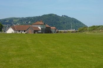 Minehead and West Somerset Golf Club: 18 Holes With Bacon Roll and Coffee For Two or Four from £28.75 (60% Off)