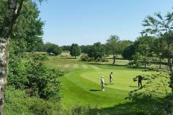Hillsborough Golf Club: 18 Holes With Range Balls and Coffee For Two or Four from £11.90 (Up to 77% Off)