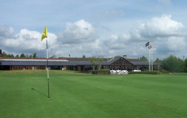18 Holes for FOUR at Dorset Golf Resort, including a Bacon Roll & Tea or Coffee each.