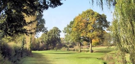 18 Holes of Golf with Bacon Roll and Coffee for Two or Four at Windmill Village Golf and Leisure Club (49% Off)