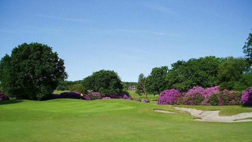 18 Holes for FOUR at Dorset Golf & Country Club, including a Bacon Roll & Tea or Coffee each.