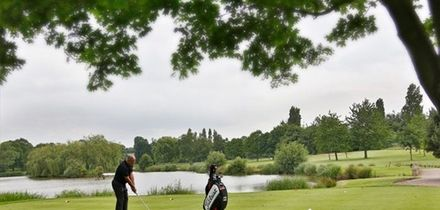 18 Holes of Golf with Bacon Roll and Coffee for Two or Four at Windmill Village Golf and Leisure Club (47% Off)